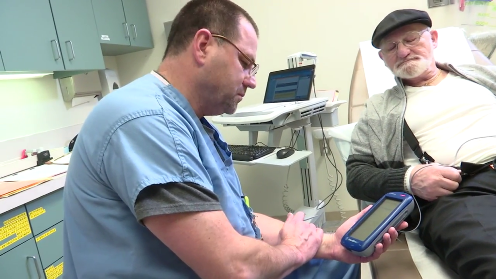 A nurse with Aurora Health Care in Wisconsin monitors a patient.